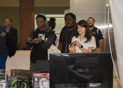 Attendees Playing a Throwback 8-bit Game