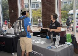 Student Learing about the USG Information Technology Store from a USG Representative